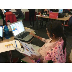 Children create their own stories with Scratch at Redbridge Central Library, UK. Credit: Vision Redbridge Culture & Leisure, UK